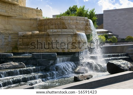 Fountain and pond at the National Museum Of The American Indian in Washington, D.C. in Washington, D.C. - stock photo