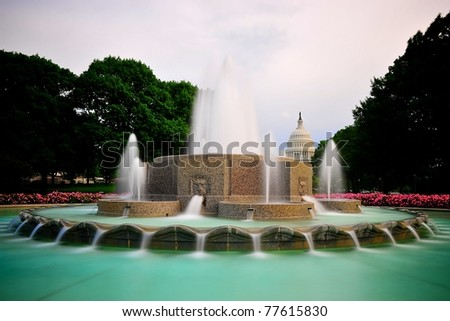 Fountain and the Capitol - stock photo