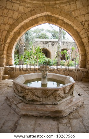 Fountain in front of an old house on Cyprus - stock photo