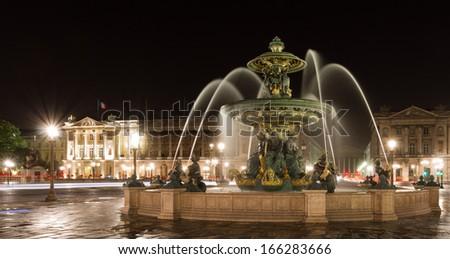 Fountain in Place de la Concorde at night, Paris, France - stock photo