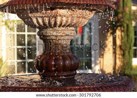 Fountain in suburban residense - stock photo