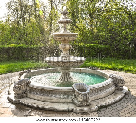 fountain multi-tiered  in the park - stock photo