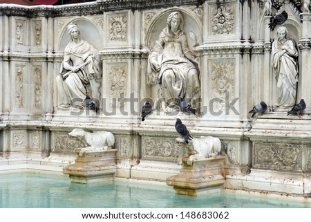 Fountain of Joy - Medieval marble fountain in Siena. Panel of the Fonte Gaia, Piazza del Campo, Siena, Italy  - stock photo