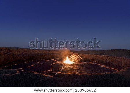 Fountain of lava in the lava lake of the Erta Ale volcano in Ethiopia. - stock photo