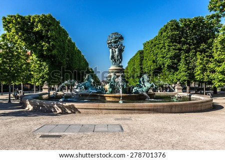 "Fountain of Observatory or Four continents (""La fontaine de l'Observatoire"", sculpture by Jean-Baptiste Carpeaux, 1874), in Jardin Marco Polo, south of Jardin du Luxembourg in Paris, France. - stock photo"