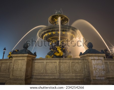 Fountain on Place de la Concorde in Paris at night , France - stock photo