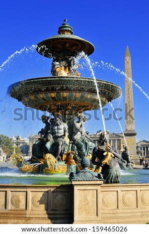 Fountain on Place de la Concorde in Paris with visible Luxor Obelisk - stock photo