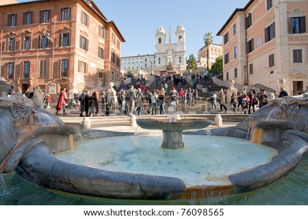 fountain on Spanish square with Spanish Steps on background, Rome - stock photo