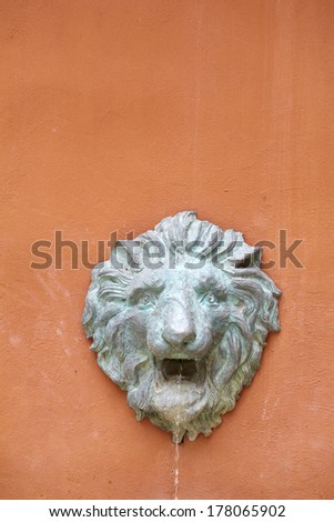 fountain on wall - stock photo