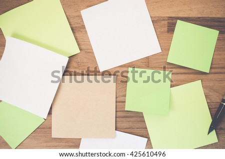 fountain pen and blank paper memos on a wood surface - copy space - stock photo