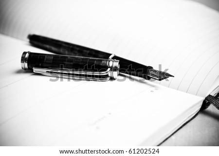 Fountain pen and calendar in composition in black and white - stock photo