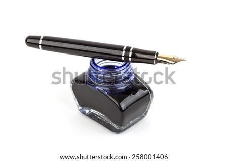 Fountain pen and inkwell over white background - stock photo