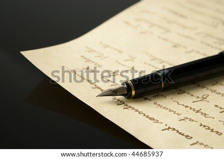 Fountain Pen and Letter with extreme shallow depth of field. Focus on very end of nib on pen. - stock photo
