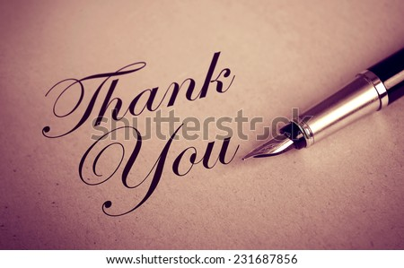 Fountain Pen and Thank You message on old paper textured background - stock photo