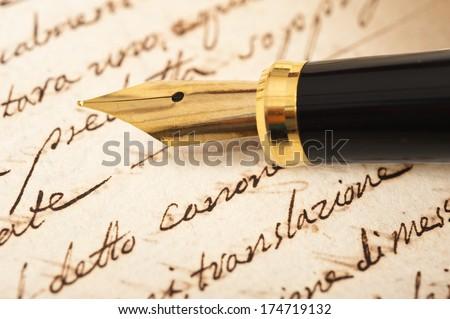 Fountain pen on an antique handwritten letter - stock photo