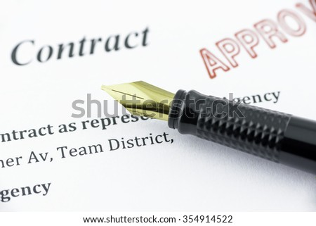 Fountain pen on an approved contract. - stock photo