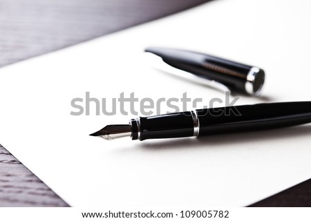 fountain pen on table - stock photo