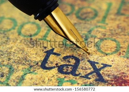 Fountain pen on tax - stock photo