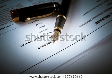 fountain pen on text sheet paper contract close-up - stock photo