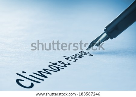 Fountain pen writing the word climate change - stock photo