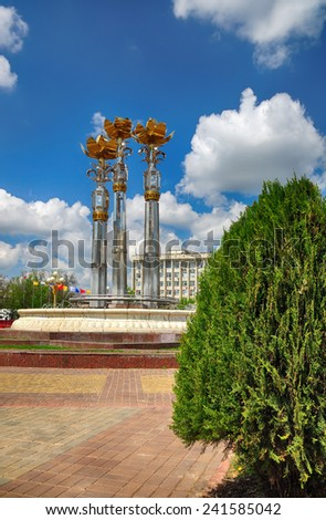 "Fountain ""Three lotus"" against the background of the Republic of Kalmykia Parliament. Elista. Kalmykia - stock photo"