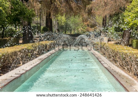Fountains in the Maria Luisa park in Seville, Spain - stock photo