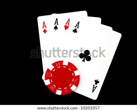 four aces and a gambling chip isolated on black - stock photo