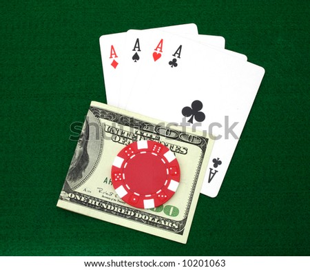 four aces and money over a green table