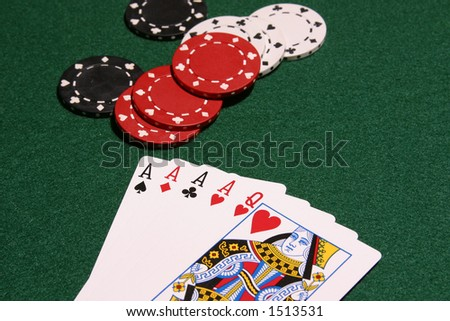 Four aces and queen of hearts on pker table with chips in background, selective focus image. - stock photo