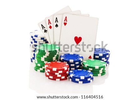 Four aces and stacks of poker chips isolated on white. - stock photo