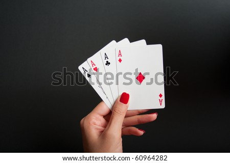 Four Aces in Woman's Hand - stock photo