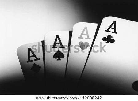 Four aces of playing cards