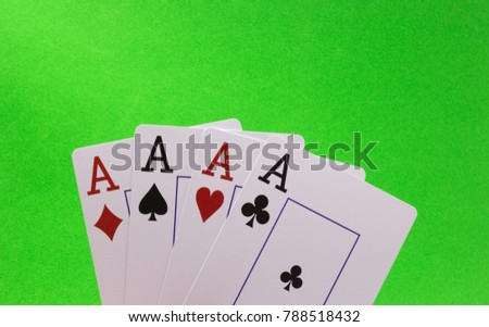 Four Aces on a Green Background