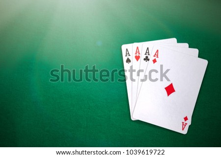 Four aces on casino table. Poker with ace high.