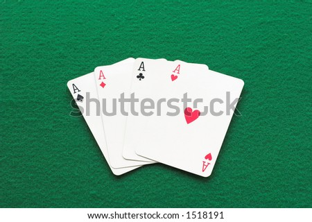 Four aces on green a background