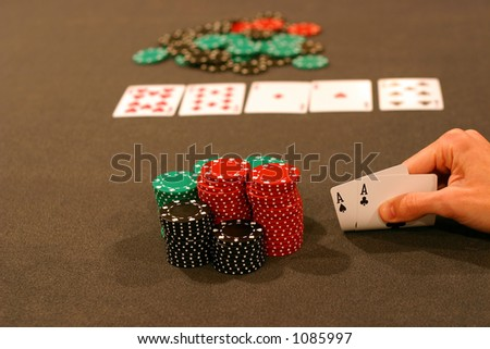 Four Aces playing Texas Hold 'em - stock photo