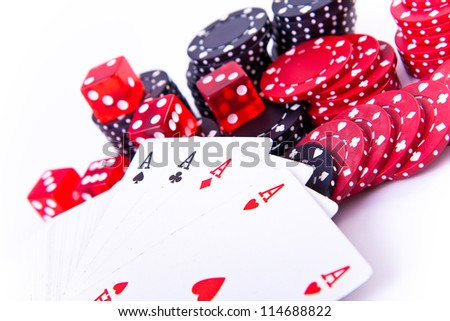 four aces with poker chips and two dice on white background - stock photo