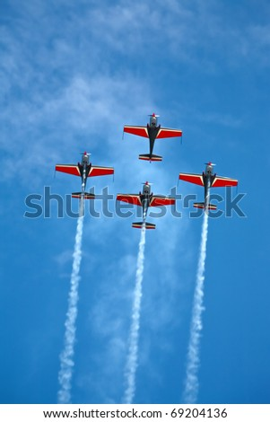four airplanes in formation on airshow - stock photo