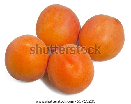 four apricots on white background