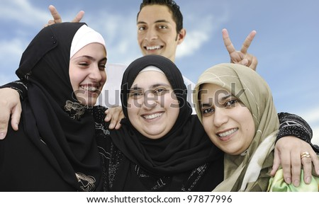 four arabic Muslim people, portrait together,with funny face - stock photo