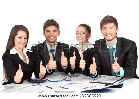 four attractive positive smile young business people sitting at desk working in team together, holding hands with thumbs up gesture Concept Success, Approval, Good Work Isolated over white background