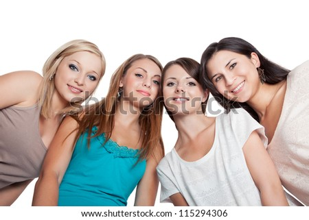 Four attractive young woman looking down at the camera with their heads close together isolated on white - stock photo