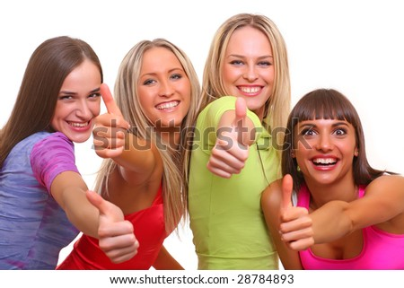Four beautiful happy young women with a smile in bright multi-coloured clothes, isolated on a white background - stock photo
