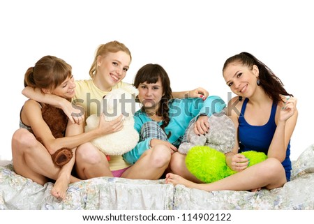 four beautiful young girls on the bed on a white - stock photo