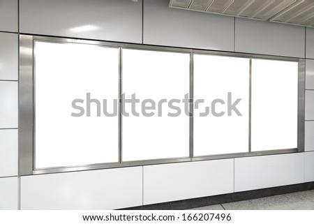 Four big vertical / portrait orientation blank billboard in public transport - stock photo