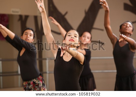 Four Black and Hispanic dance students practicing - stock photo