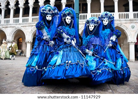 Four Blue mask in Venice, Italy. - stock photo