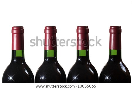 four bottles of red wine on white - stock photo