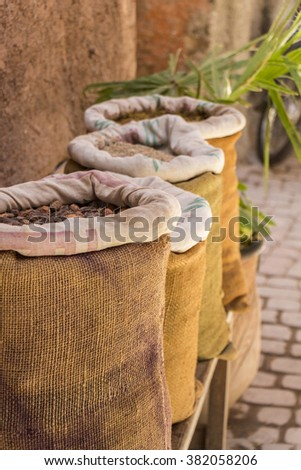 Four burlap bags filled with seeds and grains - stock photo