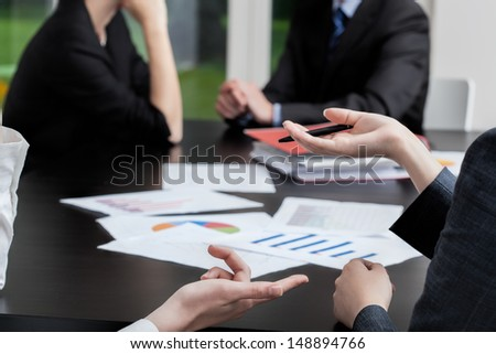 Four business people at a meeting - stock photo